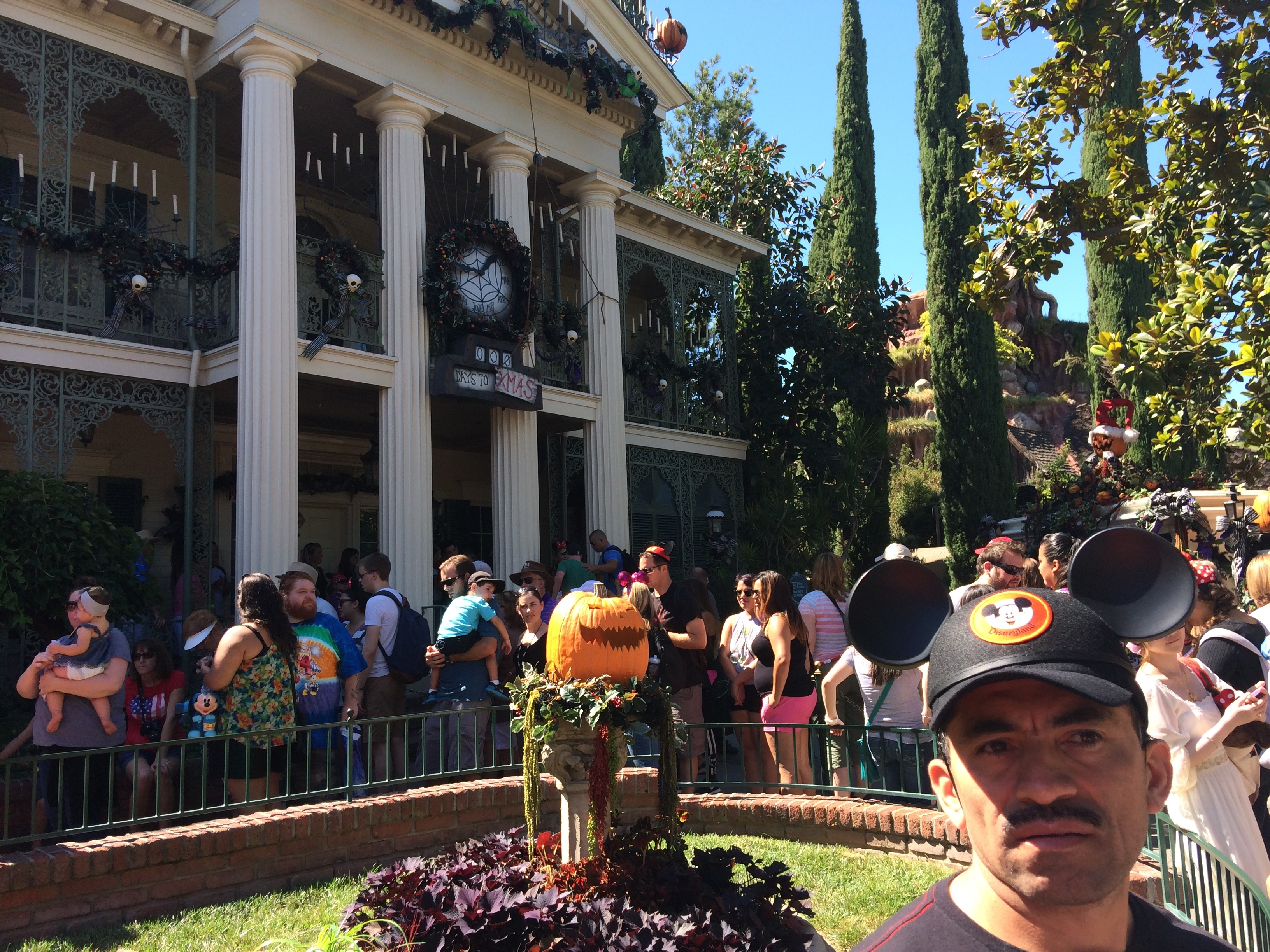 Ascención shows his fatigue while waiting to get into the Haunted Mansion